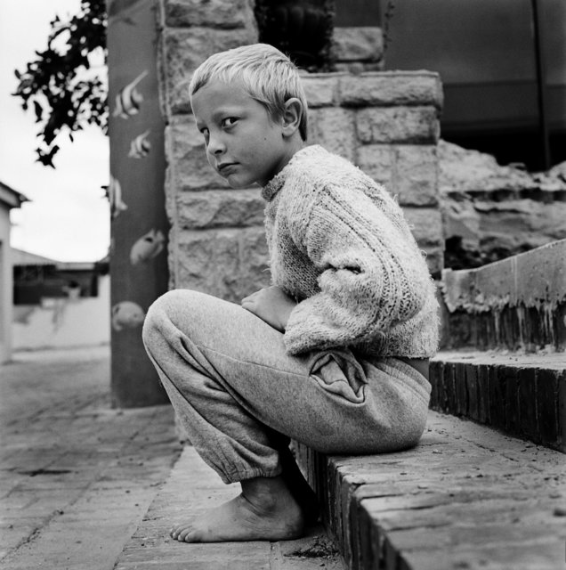 , 'Richard Schoeman, 8 Years Old, on the Steps at Jeffreysbaai, South Africa - White Africans,' 2013, Flatland Gallery