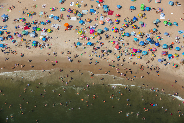 , 'Beachgoers soak in the sun in Coney Island, Brooklyn, on Labor Day Weekend.,' 2014, Anastasia Photo