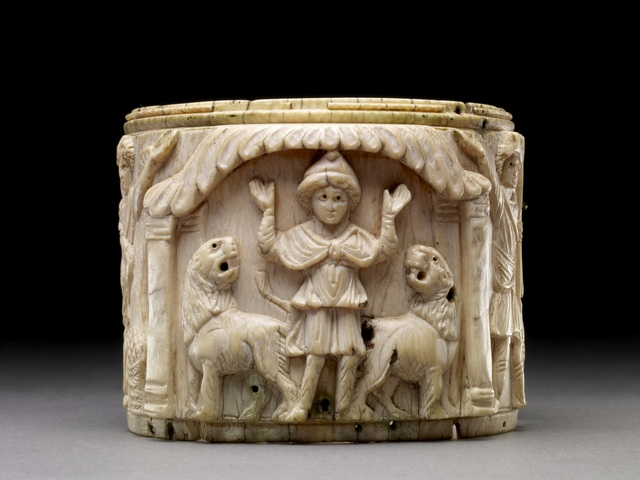 , 'Ivory pyxis box depicting Daniel with arms raised in prayer is flanked by two lions,' 5th or early 6th century AD, British Museum