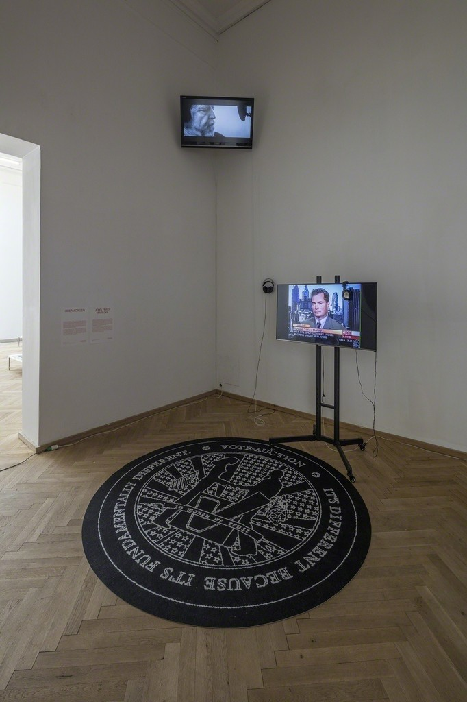 "Ubermorgen, ""Vote-Auction"", 2000. Video, 27:08 min., carpet. Installation view from 'Whistleblowers & Vigilantes, Kunsthal Charlottenborg, 2017. Courtesy of the artists and Carroll/Fletcher Gallery, London. Photo by Anders Sune Berg."