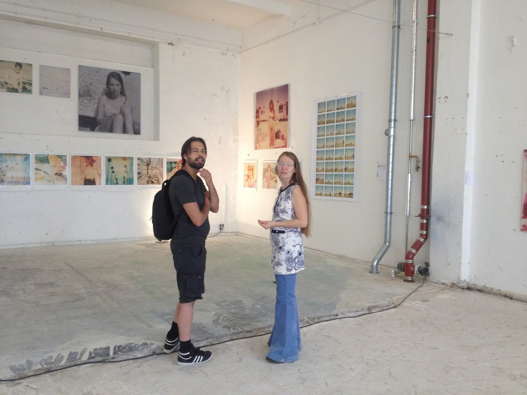 Willem Baptist (director of Instant Dreams the movie) getting a personalized tour of Stefanie Schneider's Instantdreams exhibition by the artist herself.