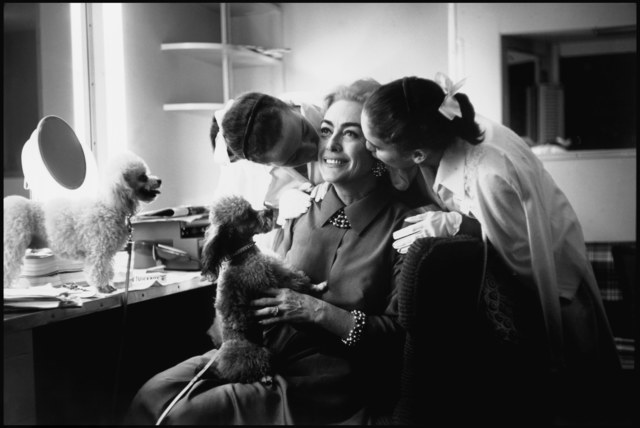 , 'Actress Joan Crawford, with her twin daughters Kathy and Cindy and her poodles. Hollywood, California. USA.   ,' 1959, Magnum Photos