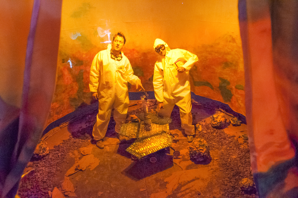 """installation view of """"Mare Tenebrarum"""" at the Museum of Human Achievement in Austin Texas. Jim Ovelmen and Andrew West in cleanroom suits"""