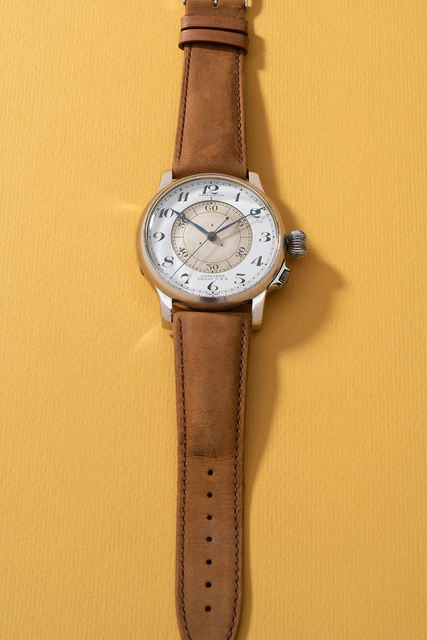 Longines, 'A fine, rare and large stainless steel pilot's wristwatch with center seconds and enamel dial, retailed by Wittanuer', 1940, Phillips