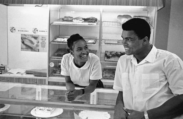 , 'Muhammad Ali Flirts with Belinda,' 1966, CAMERA WORK