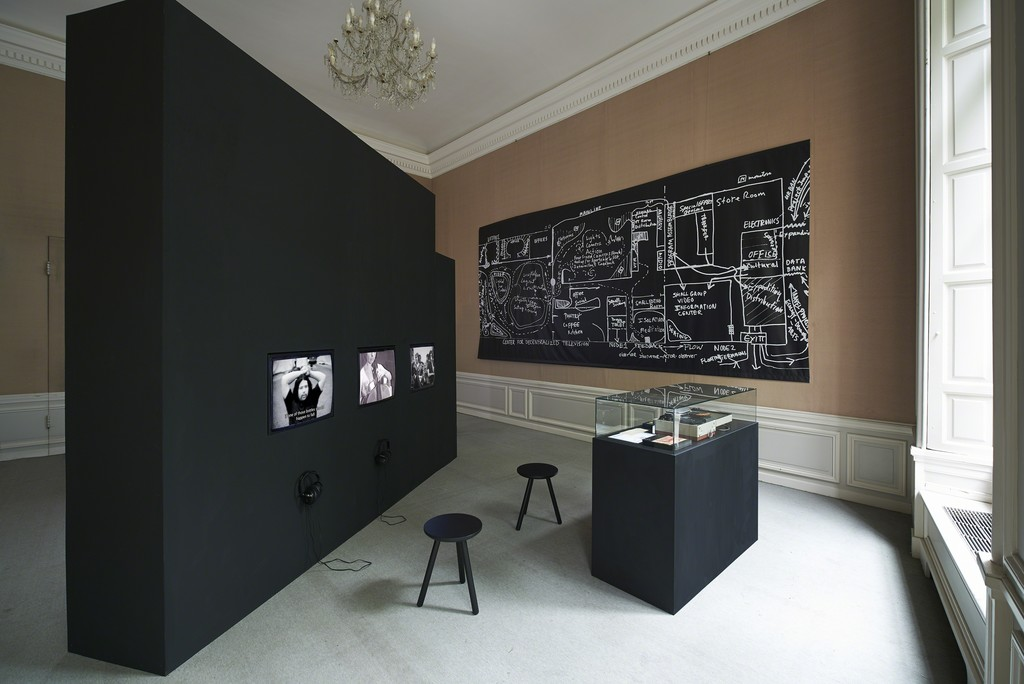 Installation view, 2018: Ira Schneider, Frank Gillette, Media Overload, 1969, 28:45 min., Ira Schneider, TV as a Creative Medium, 1969, 14:10 min., The Raindance Foundation, Meeting at NYSCA, 1970, 23:08 min., Floor plan Center for Decentralized Television, 1970, Sony Portapak, video cases, Raindance documents, 1969 - 1972 (from left to right)
