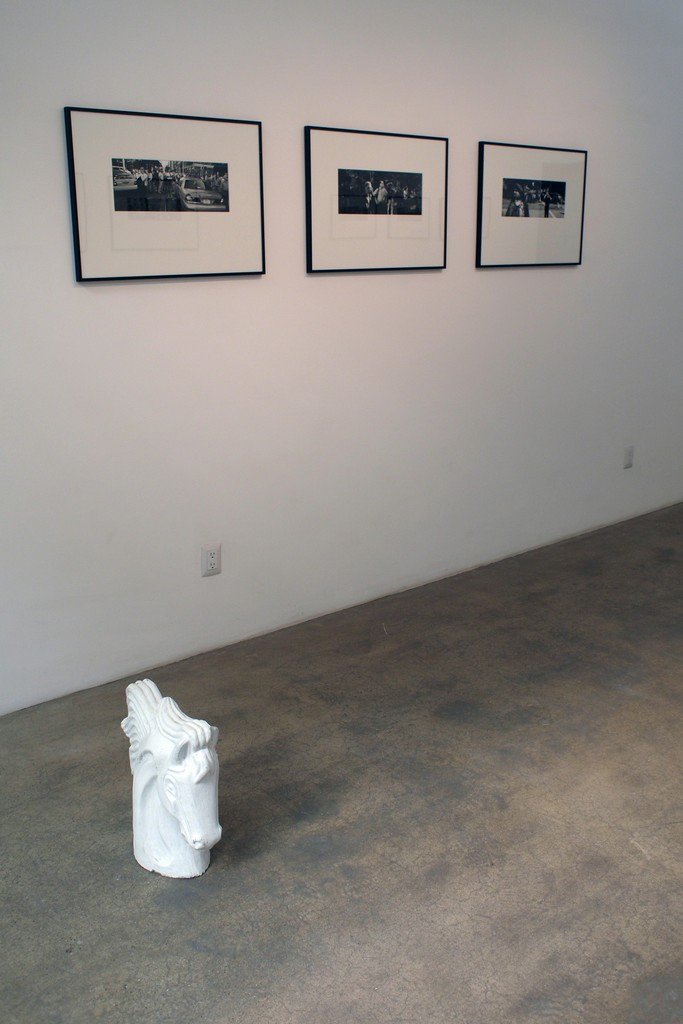 """Three fiber based gelatin silver prints of the 9/11 series, with a plaster sculpture of a horse's head an object that is a frequent ornament in the facade of houses commissioned by immigrants, and is part of the """"Arquitectura libre"""" (Free architecture). All located in the main room of the gallery"""