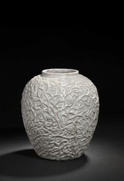 Stoneware jar modelled with branches, fruits and leaves.