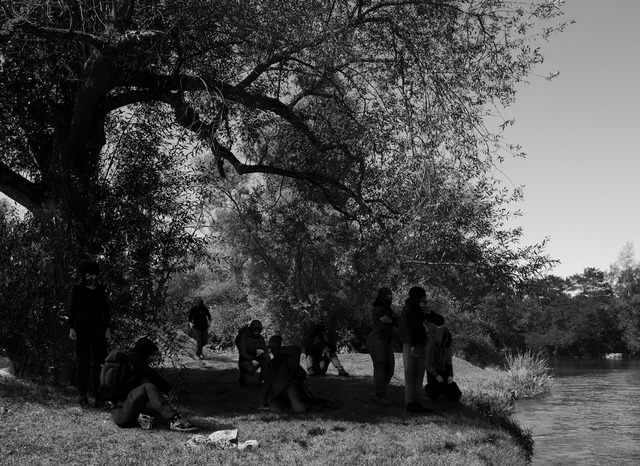 , 'GROUP OF BLACK BLOCS, WEARING SCARVES, GAS MASKS, AND MOTORCYCLE HELMETS, AT EDGE OF RIVER,' 2015, ON/gallery