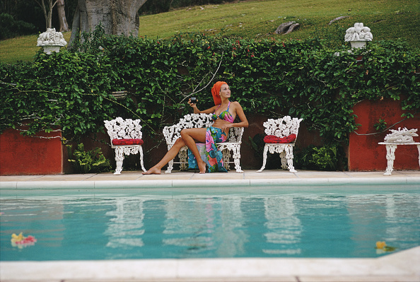 Slim Aarons, 'Jill Council relaxes with a drink by a swimming pool in Bermuda', 1969, Staley-Wise Gallery
