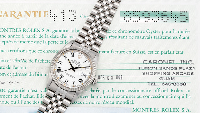 Rolex, 'A fine stainless steel and white gold wristwatch with center seconds, date, bracelet and guarantee', Circa 1986, Phillips