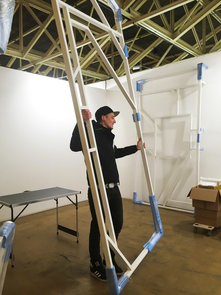 Mar von der Hocht is installing his 'Buttress', part of the artist's fair appearance.