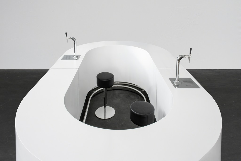 """""""Queer Bar (oval) / Powerless Structures, Fig.221"""" 2018 Corian, MDF, stainless steel, beer taps, stools h. 113 × L. 375 × l. 220 cm, Ø 130 cm 