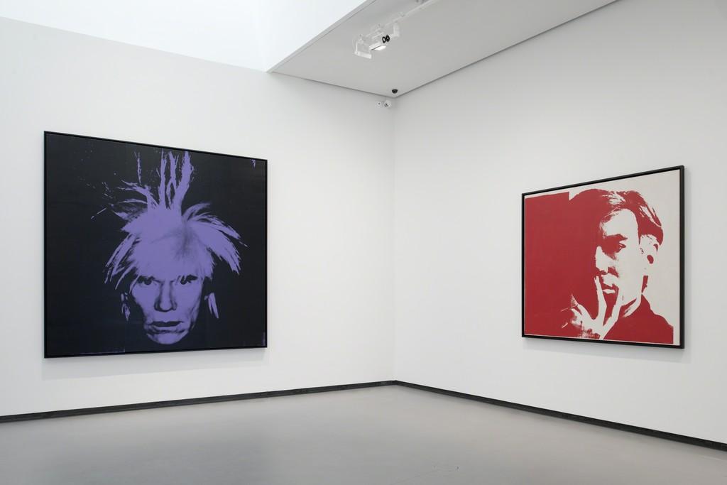 """Installation view of Andy Warhol, """"Self-Portrait"""" (1986) and """"Self-Portrait"""" (1967). Fondation Louis Vuitton, Paris. © The Andy Warhol Foundation for theVisual Arts, Inc. / Adagp, Paris 2015 pour l'œuvre de l'artiste. Photo Fondation Louis Vuitton / Martin Argyroglo."""