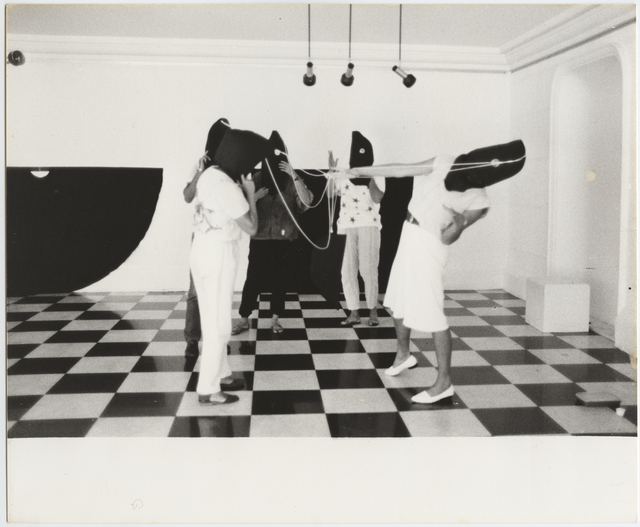 ", 'Photographic documentation of the performance ""Capacete"", from the series ""Hábito/Habitante"",' 1985, Galeria Jaqueline Martins"