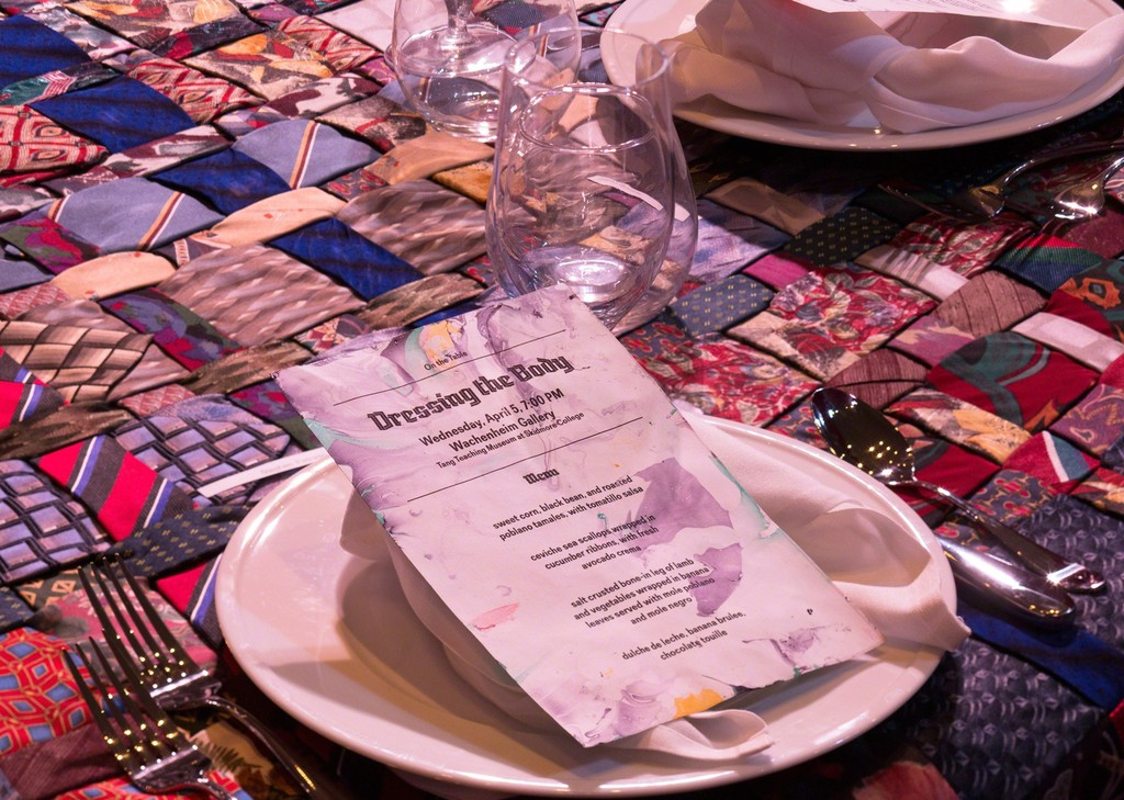 "Table setting for a themed dinner in ""On the Table,"" a performative tablecloth comprised of 210 vintage ties, in the exhibition ""Janine Antoni & Stephen Petronio: Entangle,"" Tang Teaching Museum, April 4, 2017"