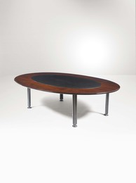 A T17 table with a metal structure and a wooden top with a leather insert