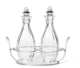 Pyramid. Oil and vinegar set with sterling silver stand and stoppers. Bottles of clear glass with cuttings.