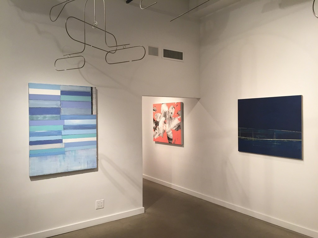 Paintings from left: Mark Zimmermann, Jeff Muhs, Gayle Ruskin. Ceiling sculpture by Rodger Stevens