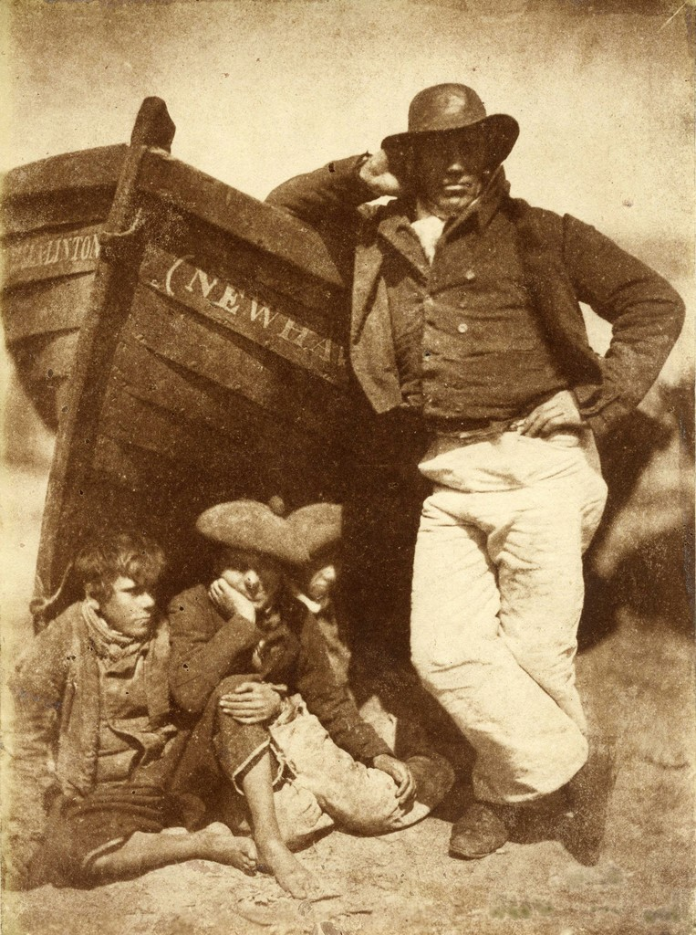 D.O. Hill and Robert Adamson. Sandy Linton, his boat and his bairns, New Haven, 1845, Salt print from a calotype negative, 7 5/8 x 5 3/4 inches. Collection of Michael Mattis and Judy Hochberg.