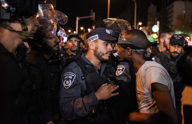 , 'Ethiopian Israelis confront police officers during a protest near Azrieali Towers in central Tel Aviv. 10 Protesters were arrested. June, 2015,' 2015, Ronald Feldman Gallery