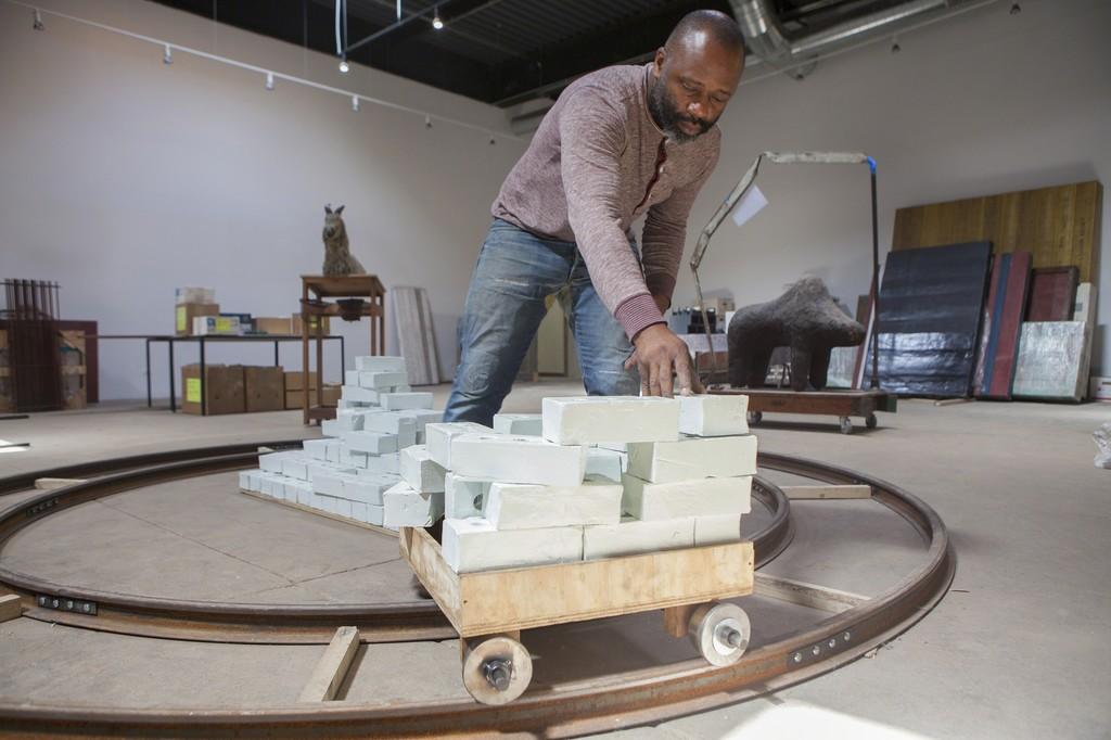 Theaster Gates with Goat in his studio 