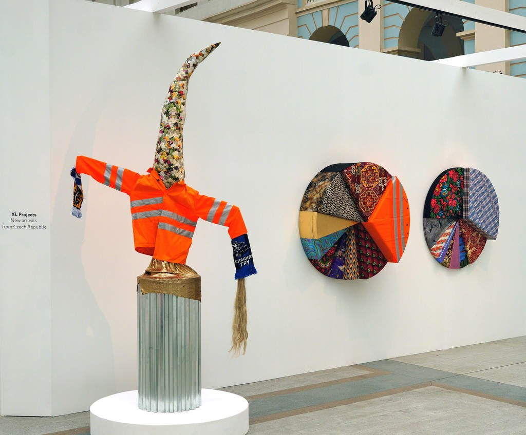 Stand view with Scarecrow (left) and works from Infographics deris (center, right) by Irina Korina
