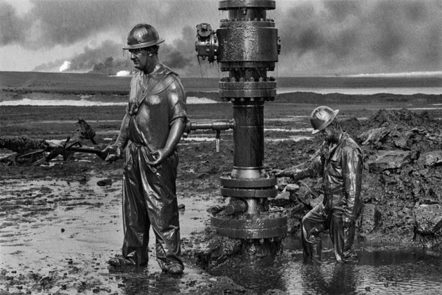 ", 'Workers install a new wellhead to enable the injection of a chemical mud to ""kill the old well."" Greater Burhan, Kuwait.,' 1991, Sundaram Tagore Gallery"