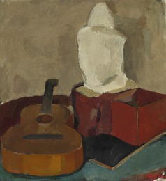 Still life with guitar and figure on a table