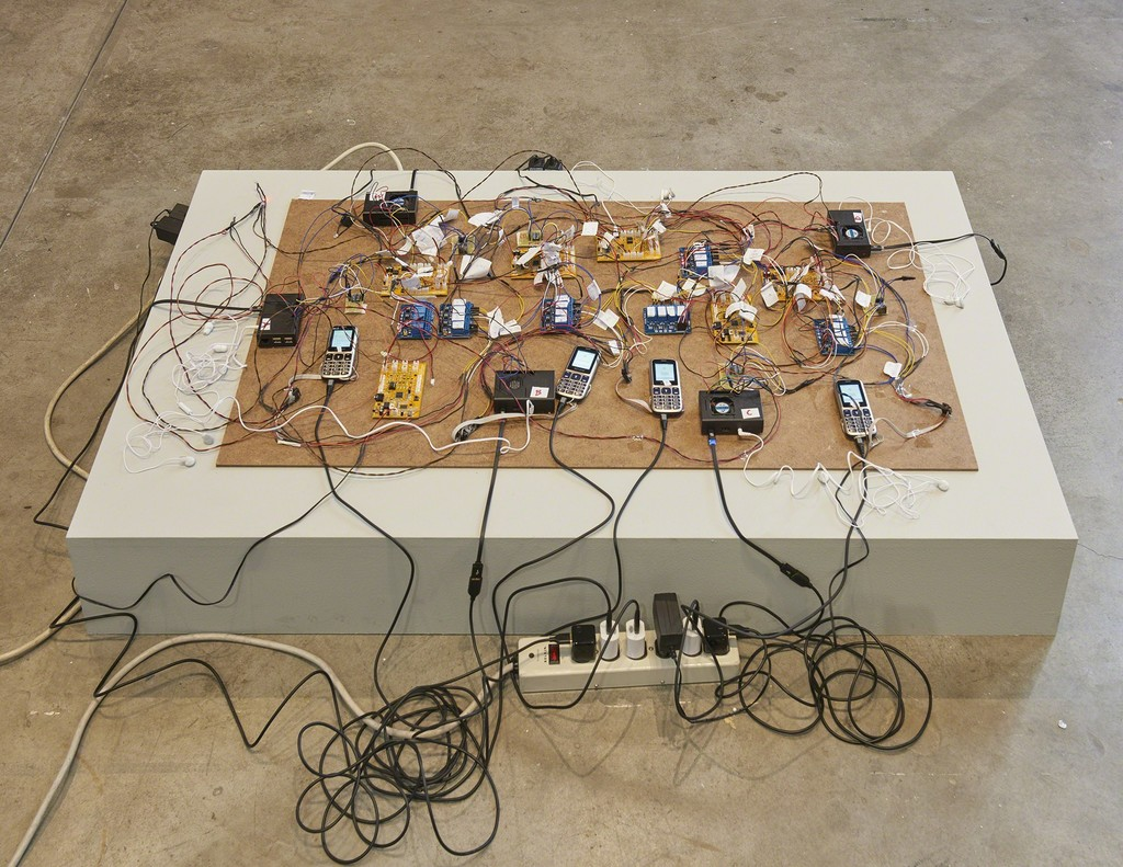 Shadi Habib Allah, Did you see me this time, with your own eyes?, 2018, detail, 74 million million million tons, SculptureCenter, New York, 2018. Raspberry Pi computers, Z-Line phones and chargers, microcontrollers, video with sound. Dimensions variable. Courtesy the artist, Green Art Gallery, Dubai and Rodeo, London. Photo: Kyle Knodell