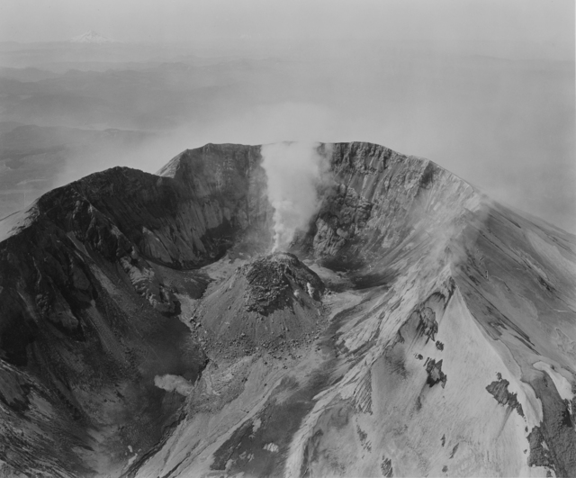 , 'Aerial view: looking south at Mount St. Helens crater and lava dome, Mount Hood and Mount Jefferson in the distance, airplane in crater,' 1982, Etherton Gallery