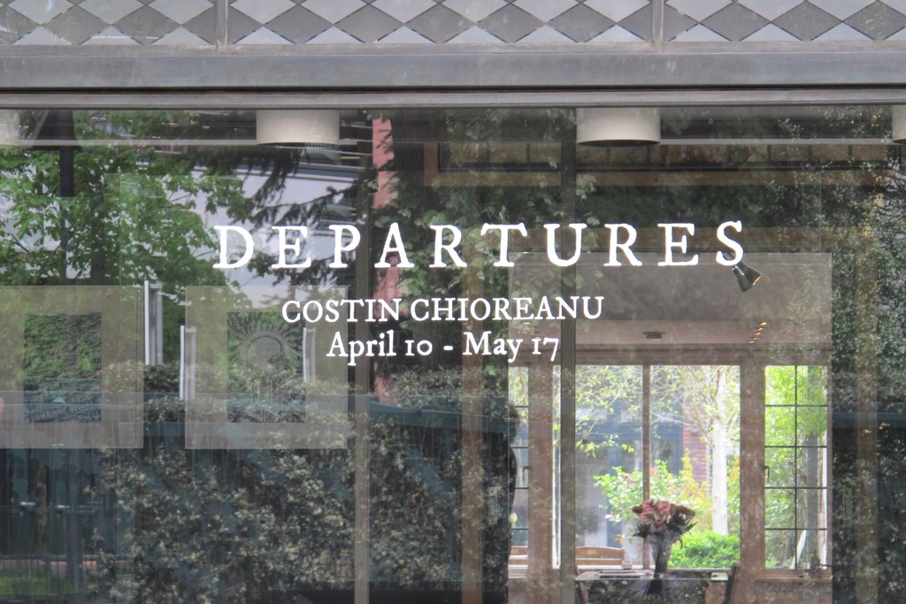 Window lettering for solo exhibition 'Departures, The Black Ink Works of Costin Chioreanu'.
