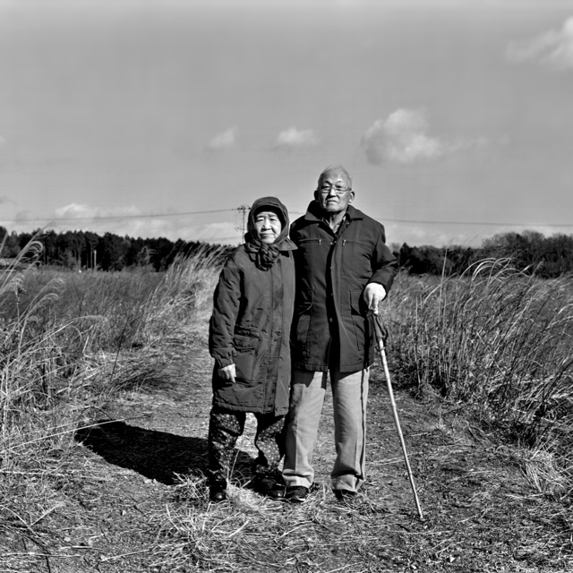 , 'Tomioka, Fukushima —Farmers Taisuke and Itsuko Saito standing in their rice field,' , KANA KAWANISHI GALLERY