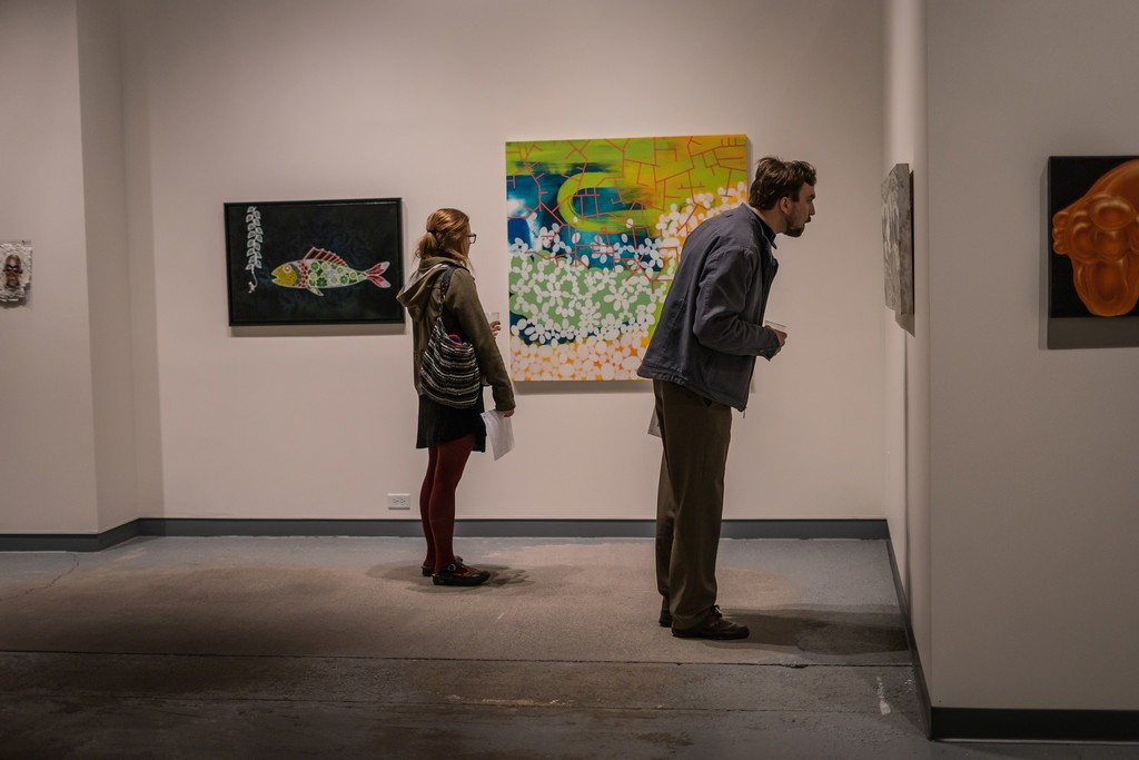 Sweep Opening, viewers looking at the work of (L to R): Christopher Harrison, Leah Yellowbird, Heidi Pollard and Karen Owsley Nease.