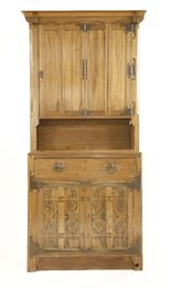 A Continental Arts & Crafts oak bookcase