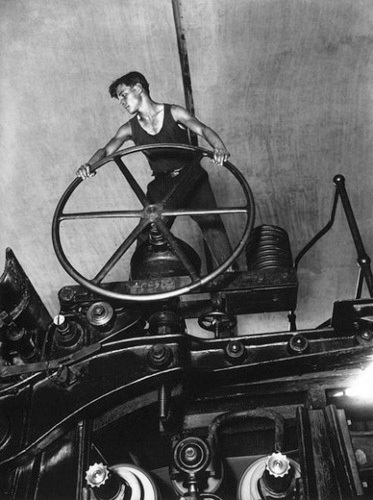 , 'Komsomol member at the wheel of papermaking machine,' 1929, Lumiere Brothers Gallery