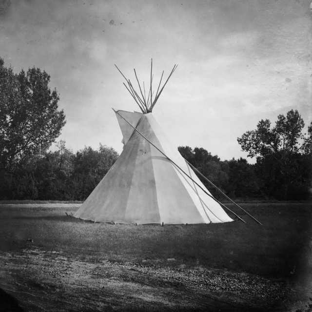 , 'A tipi stands outside the George Gordon First Nation band office.,' 2015-2016, Anastasia Photo