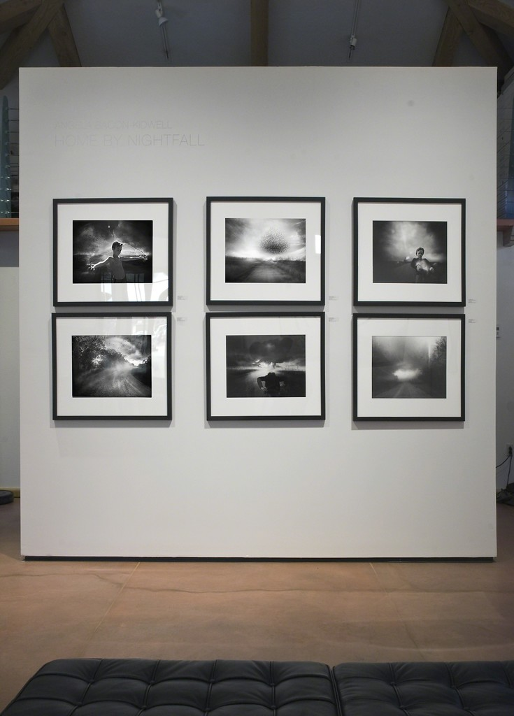 Images from Angela Bacon-Kidwell's series Home By Nightfall installed in photo-eye Gallery's Main room.