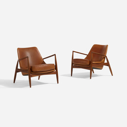Seal lounge chairs, pair