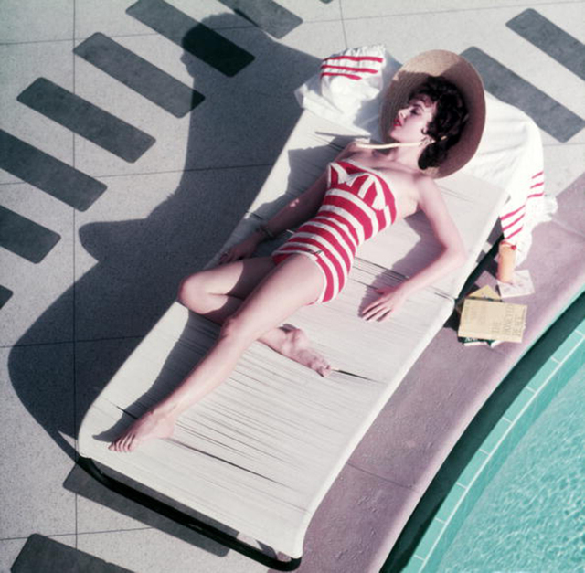 , 'Mara Lane at The Sands, 1954: Austrian actress Mara Lane lounging by the pool in a red and white striped bathing costume, Las Vegas,' 1954, Staley-Wise Gallery