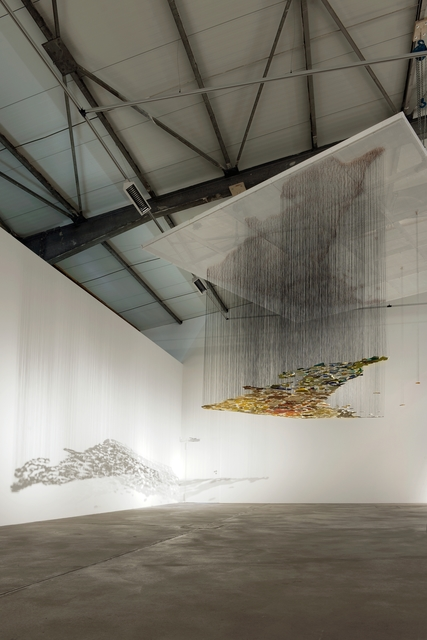 Nadia Kaabi-Linke, 'Understanding Overviews', 2009, Installation, Collected pieces of chipped off layers of paint from walls in Berlin, Venice, Naples, Bizerte, Tunis, Kairouan, Cologne and Zagreb, black silk threads, metal grid, paper clips and spotlights, Lawrie Shabibi