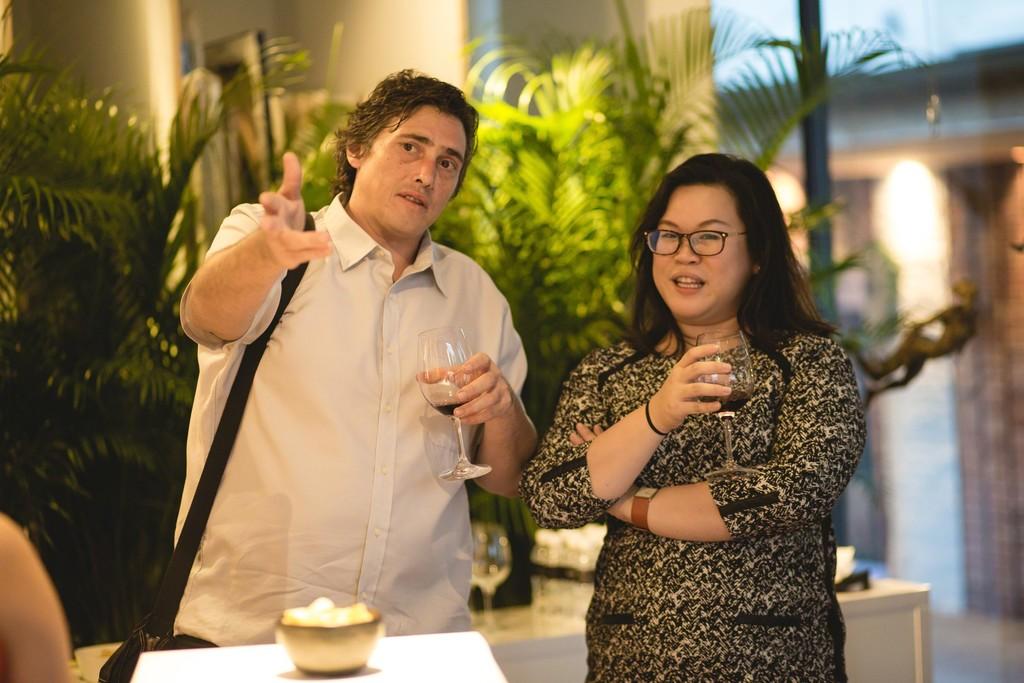 Didier Lourenço speaking with gallery founder Abigail Wong.