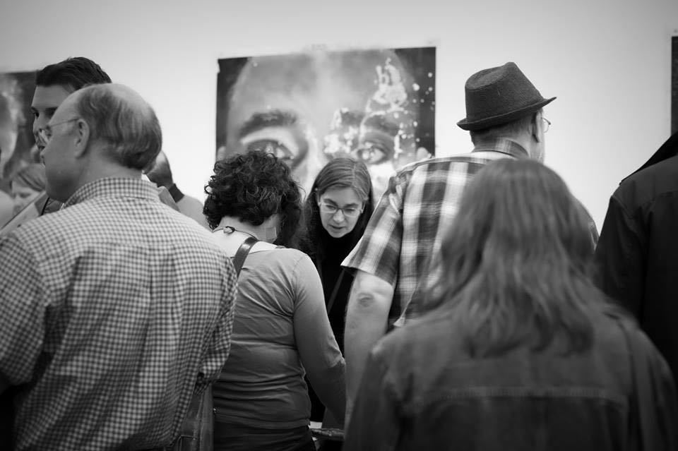Photograph by Constance Brinkley, Michelle Dunn Marsh selling books at Photolucida, 2017