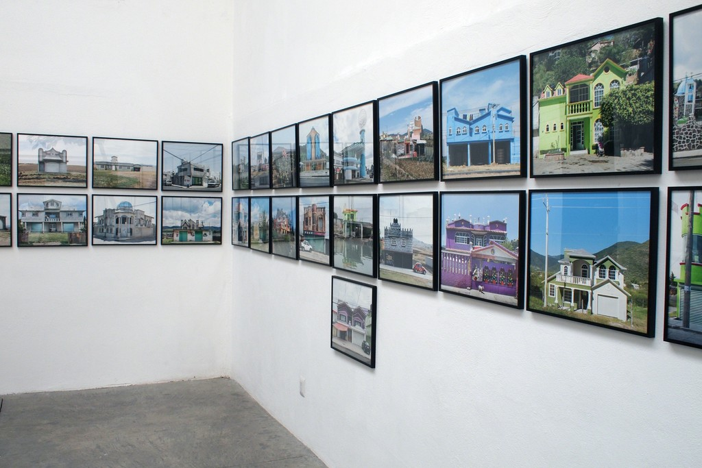 """An array of prints part of the """"Arquitectura libre"""" series, at the patio gallery"""