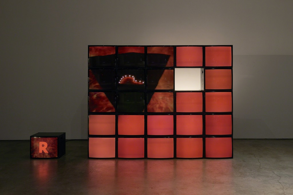 Maria Vedder, PAL oder Never The Same Color, 1988, installation view. Video installation with twenty-five monitors, sound. 7.6 x 13.7 x 1.2 feet (2.33 x 4.17 x 0.42 m). 5:32 minutes. Courtesy the artist Photo: Kyle Knodell