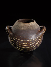 Early and large globular pot with handles and abstract design