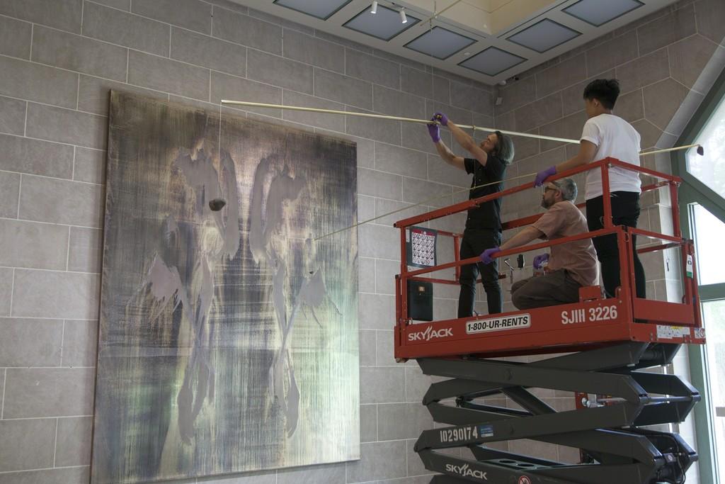 Michael Joo installing piece.