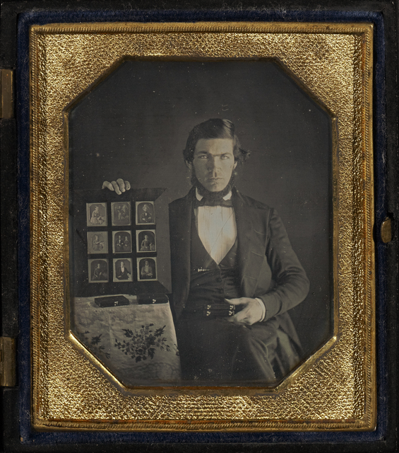 , 'Portrait of an Unidentified Daguerreotypist Displaying a Selection of Daguerreotypes,' 1845, J. Paul Getty Museum