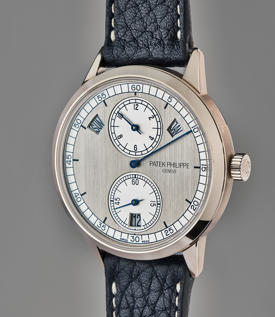 Patek Philippe, 'A very fine and rare white gold annual calendar wristwatch with regulator-style dial, Certificate of Origin, and presentation boxes', 2013, Phillips