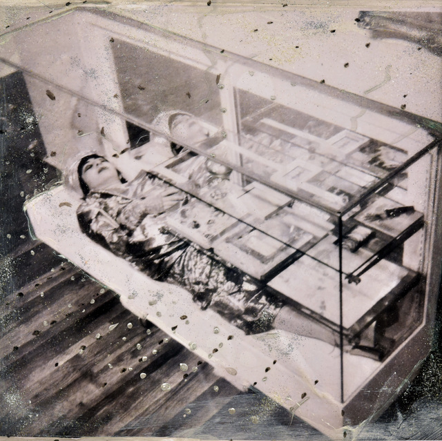 """, '""""Olympia practices being 2 places at one time"""". Rempire Gallery NYC. House of Olympia  Sleeping in a glass cabinet . Part of installation/performance 'Retrieving my history"""",' 1991, Galerie Kornfeld"""